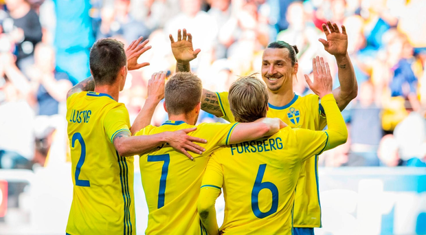Sweden's midfielder Emil Forsberg (6) celebrates with his forward and team captain Zlatan Ibrahimovic and teammates after scoring a goal during the friendly against Wales .Getty Images