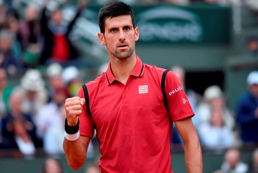Serbia's Novak Djokovic reacts during his men's final match against Britain's Andy Murray at the Roland Garros 2016 French Tennis Open in Paris on June 5, 2016. / AFP PHOTO / PHILIPPE LOPEZPHILIPPE LOPEZ/AFP/Getty Images