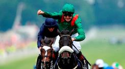 Pat Smullen celebrates as he crossed the Derby winning line on Harzand. Photo: David Davies/PA Wire.