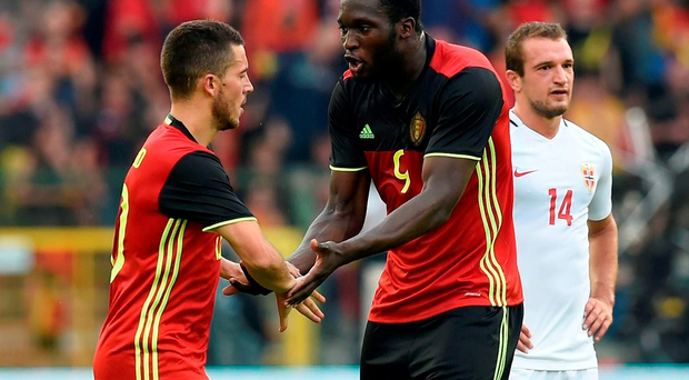 Belgium's midfielder Eden Hazard (L) celebrates after scoring during the friendly football match between Belgium and Norway, at the King Baudouin Stadium, on June 5, 2016 in Brussels. / AFP PHOTO / JOHN THYSJOHN THYS/AFP/Getty Images
