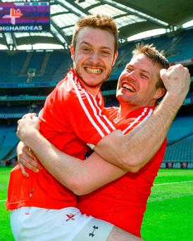 Darren O'Hanrahan and Gerard Smith, right, of Louth celebrate a dramatic victory. Photo by Piaras Ó Mídheach/Sportsfile