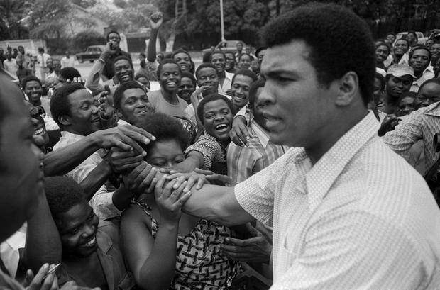 Muhammad Ali is greeted in downtown Kinshasa, Zaire before his 'Rumble in the Jungle' meeting with George Foreman in 1974. Pic: Associated Press