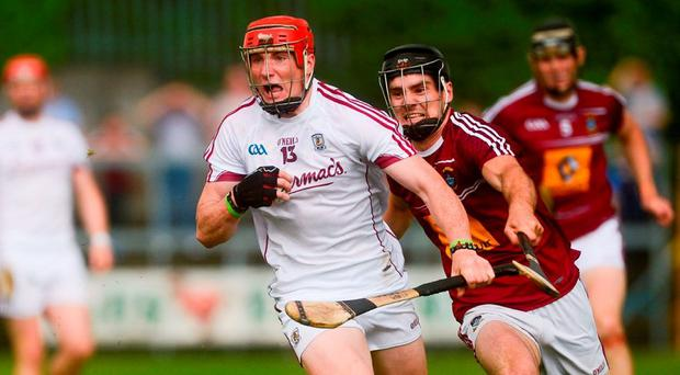 Galway's Conor Whelan races clear of Westmeath's Aonghus Clarke during yesterday's Leinster SHC quarter-final at Cusack Park, Mullingar. Photo: Piaras Ó Midheach/Sportsfile