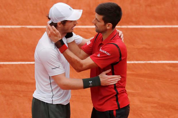Andy Murray (l) congratulates Novak Djokovic after his French Open success. Photo: Reuters