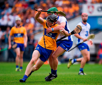 Clare's William Hahessy attempts to get away from Danny Russell of Waterford in the Munster IHC semi-final. Photo: Sportsfile