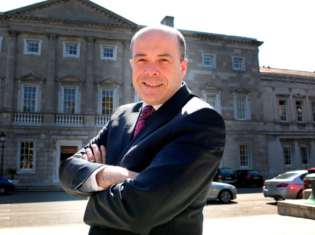 Denis Naughten, the Minister for Communications, Climate Change and Natural Resources, at Leinster House Photo: Tom Burke