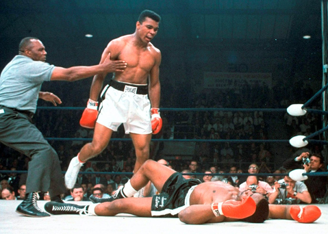 Muhammad Ali towers over a defeated Sonny Liston during their 1965 re-match, following his stunning upset victory a year earlier Photo: AP Photo/File