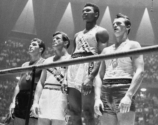 On the podium after winning a gold medal at the 1960 Olympics in Rome Photo: Central Press