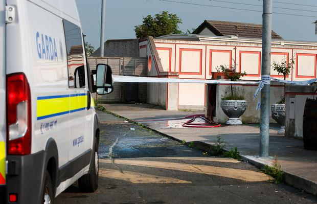 Gardai at the scene of a fatal stabbing on Dunsink Lane in Finglas. Picture: Gerry Mooney