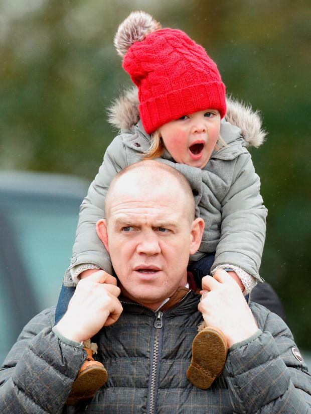 Mia Tindall yawns as she rides on her father Mike Tindall's shoulders as they attend the Gatcombe Horse Trails at Gatcombe Park, Minchinhampton on March 26, 2016 in Stroud, England. (Photo by Max Mumby/Indigo/Getty Images)