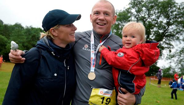 Zara Phillips and daughter Mia Tindall pose for a photograph after husband Ex England rugby star Mike Tindall finished the grueling Artemis Great Kindrochit Quadrathlon in Loch Tay Scotland on July 11, 2015 in Aberfeldy, Scotland. (Photo by Nigel Roddis/Getty Images for Artemis Quadrathlon)