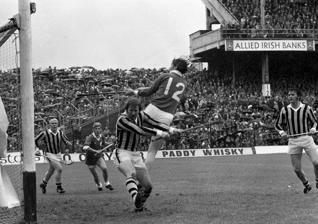 'Brave Save' - Kilkenny's Noel Skehan clears his goal as Limerick's Matt Ruth 'hitches-a-ride' in the big match. All-Ireland Hurling Final at Croke Park. (Part of the Independent Newspapers Ireland/NLI collection.)