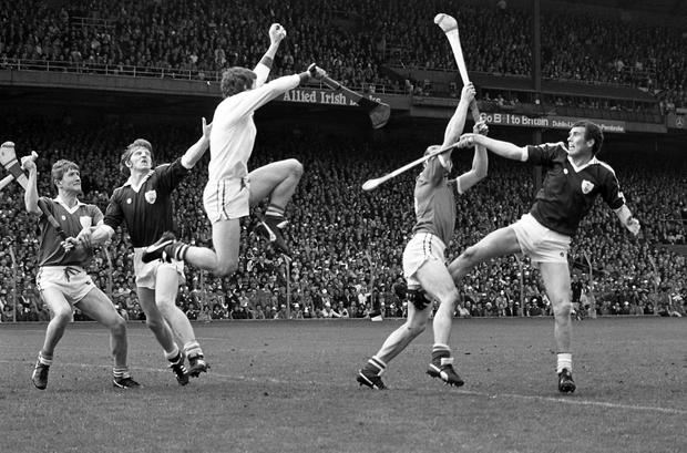 A brave Tommy Quaid, the Limerick keeper, saves under pressure from John Connolly of Galway, during the All-Ireland Hurling Final in Croke Park. Pic: Donal Doherty, 7/9/80. All-Ireland Hurling Final, September 7th 1980. Galway 2-15 Limerick 3-9. (Part of Independent Newspapers Ireland/NLI Collection)