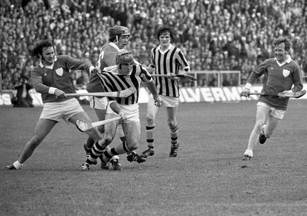'Hey! Come back here'...Limerick's Willie Moore, grabs in desperation at the jersey of Mick Brennan of Kilkenny as he dashes through to have a shot at goal. All-Ireland Hurling Final at Croke Park. 1/9/74