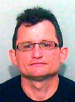 Ali Qazimaj, 42, who police are looking for after the murder of a pensioner and disappearance of his elderly wife