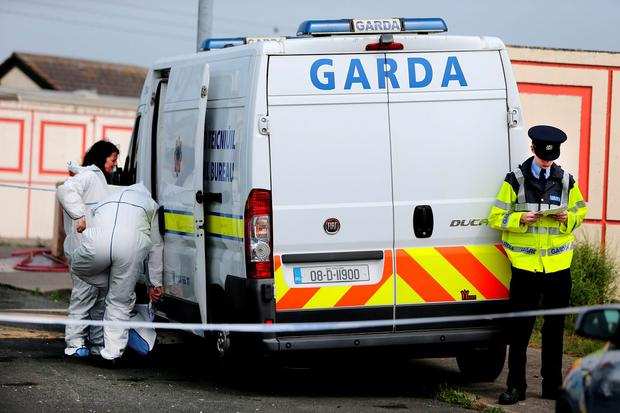 Forensic Gardai at the scene of a fatal stabbing on Dunsink Lane in Finglas. Photo: Gerry Mooney.