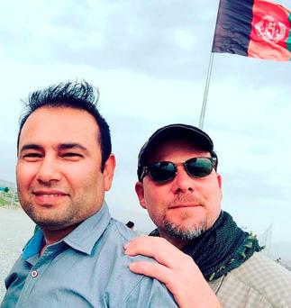 This undated photo provided by NPR shows Zabihullah Tamanna, left, and David Gilkey. Gilkey, a veteran news photographer and video editor for National Public Radio, and Tamanna, an Afghan translator (Monika Evstatieva/NPR via AP)