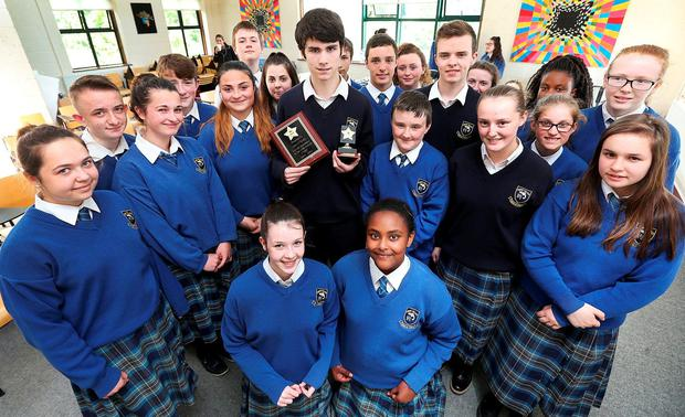 Alan O'Reilly (pictured centre) with fellow pupils of Confey Community College in Leixlip, Co Kildare. Alan was presented with an award in recognition of his perfect attendance record throughout his school years. Photo: Steve Humphreys