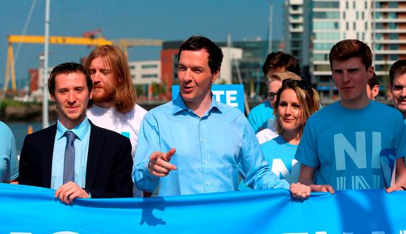 George Osborne pictured at Belfast Harbour with members of the NI Stronger In campaign group. The UK Chancellor has warned of a return to a border clampdown between Northern Ireland and the Republic if Britain leaves the EU. Photo: Niall Carson/PA Wire