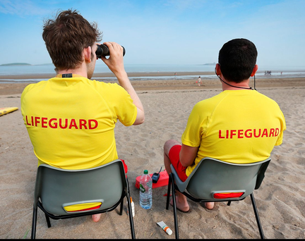 Lifeguards watching swimmers at Skerries Beach yesterday Photo: Steve Humphreys