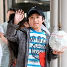 Seven-year-old Yamato Tanooka, who was found by authorities in the woods nearly a week after his parents abandoned him for disciplinary reasons, waves as he leaves a hospital in Hakodate on the northernmost Japanese main island of Hokkaido, Japan, in this photo taken by Kyodo on June 7, 2016