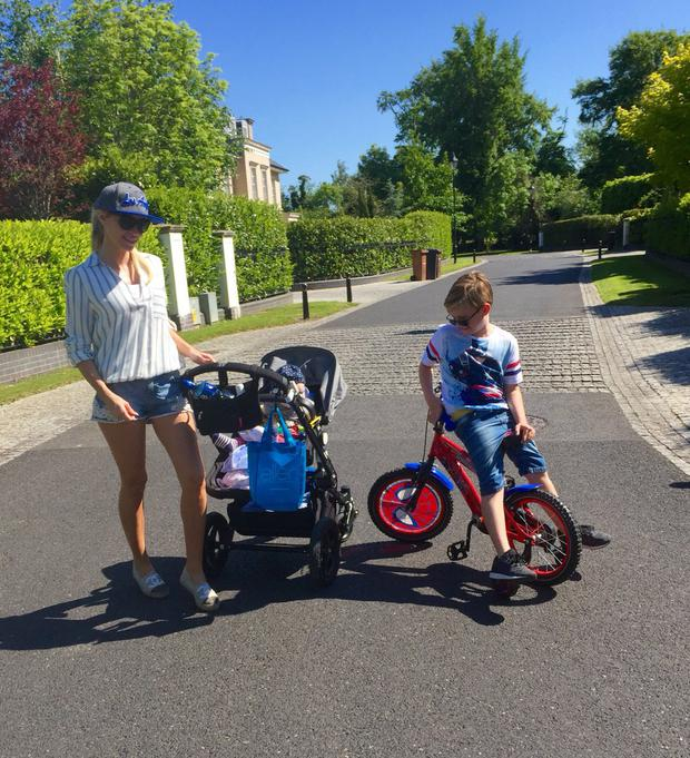 Claudine with sons Robert Jr and Hudson in sunny Malahide. Photo: Claudine Keane / Twitter