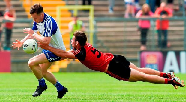 Despite the best efforts of David McKibbin, seen here tackling Monaghan's Karl O'Connell, Down suffered one of their heaviest SFC defeats in Clones on Sunday. Photo: Philip Fitzpatrick/SPORTSFILE