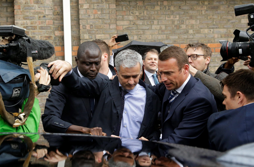 Jose Mourinho is escorted through the media scrum after attending an employment tribunal for former Chelsea team doctor Eva Carneiro in London yesterday. Photo: Matt Dunham
