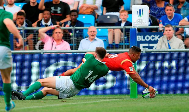 Keelan Giles scores a try for Wales. Photo: PA