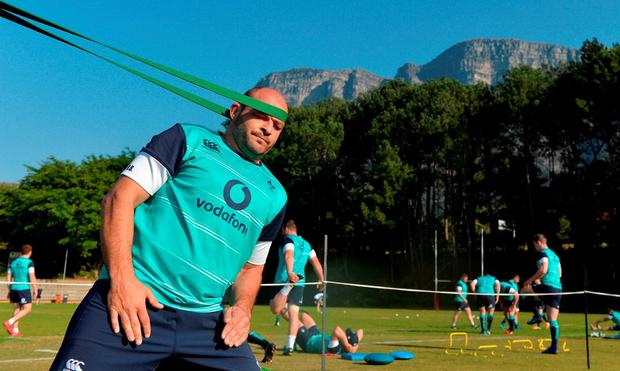 Ireland captain Rory Best gets in some unconventional stretching exercise, with Table Mountain in the background, in Cape Town yesterday BRENDAN MORAN/SPORTSFILE