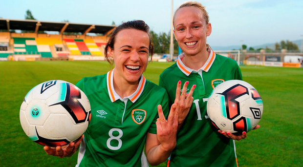 Ireland's Aine O'Gorman, left, and Stephanie Roche, right, celebrate after scoring a hat-trick each