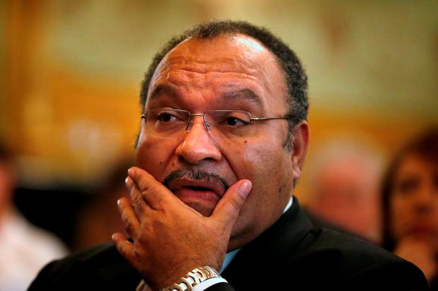 Papua New Guinea's Prime Minister Peter O'Neill pauses before making an address to the Lowy Institute in Sydney November 29, 2012. REUTERS/Tim Wimborne/File Photo