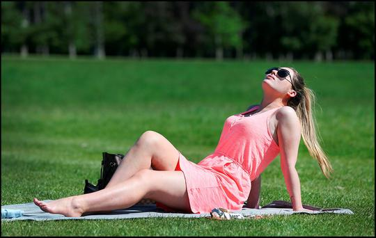 Soaking up the sun in the Phoenix Park was Claudia Doyle from Castleknock. Pic Steve Humphreys