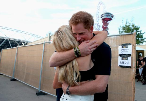 Prince Harry hugs Ellie Goulding backstage at the Invictus Games Closing Ceremony during the Invictus Games at Queen Elizabeth park on September 14, 2014