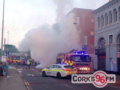 The scene at Camden Quay as Cork fire brigade battle a fire in a food outlet on the ground floor of an apartment complex (Pic- 96fm)
