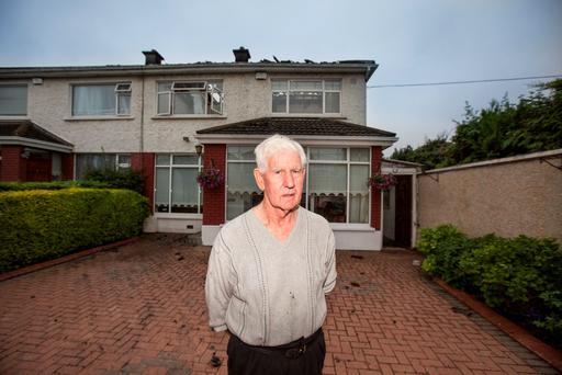 Christy Stenson outside his home which burst into flames in the early hours of Wednesday morning on Walnut Rise in Glasnevin. Pic:Mark Condren