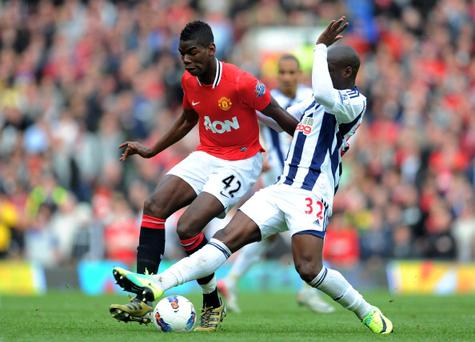 MANCHESTER, ENGLAND - MARCH 11: Paul Pogba of Manchester United is challenged by Marc-Antoine Fortune of West Bromwich Albionduring the Barclays Premier League match between Manchester United and West Bromwich Albion at Old Trafford on March 11, 2012 in Manchester, England. (Photo by Michael Regan/Getty Images)