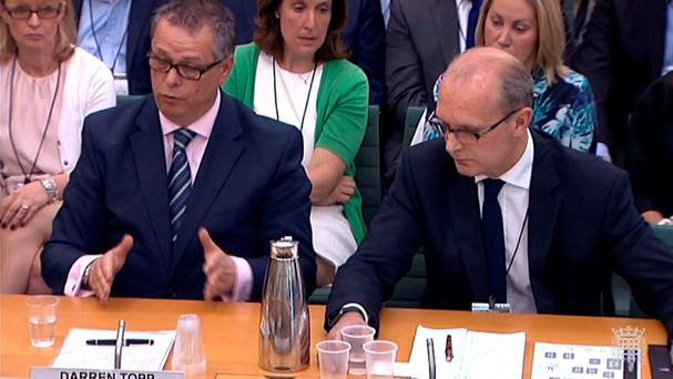 RETRANSMISSION AMENDING NAME OF MAN ON RIGHT TO MICHAEL HITCHCOCK Darren Topp, BHS chief executive, (left) and Michael Hitchcock, former BHS financial adviser, give evidence to MPs over the retailer's collapse. PRESS ASSOCIATION Photo. Picture date: Wednesday June 8, 2016. Last week administrators to the department store chain called time on trying to find a buyer, resulting in the loss of up to 11,000 jobs. PA Wire