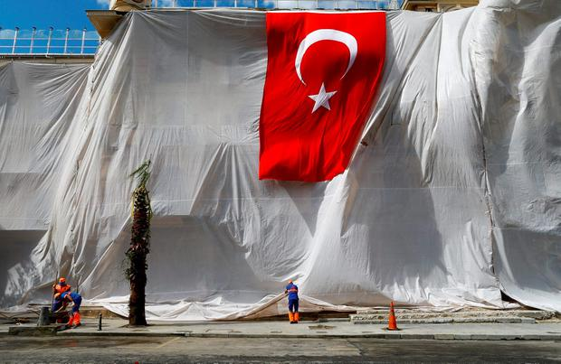 A building is seen covered and decorated with a Turkish flag after Tuesday's car bomb attack on a police bus, in Istanbul, Turkey, June 8, 2016. REUTERS/Osman Orsal
