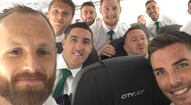 The Irish players pose for a selfie before take-off
