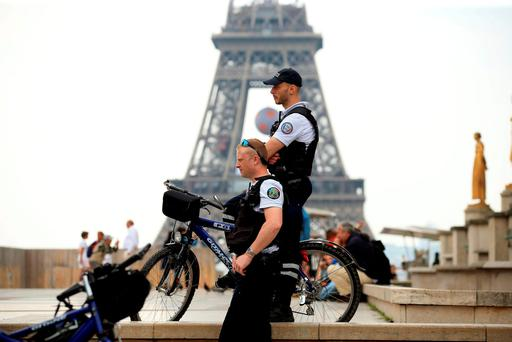 Security presence near the Eiffel Tower, Paris. Mike Egerton/PA Wire.