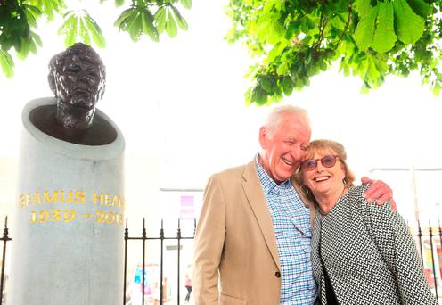 Marie Heaney and her brother-in-law Hugh Heaney, the brother of poet laureate Seamus Heaney, attend the unveiling of a bust in honour of her late husband Photo: Brian Lawless/PA Wire