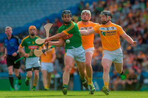Joe Keena of Meath in action against Conor McAuley and Neal McAuley, right, of Antrim the Christy Ring Cup Final between Antrim and Meath in Croke Park, Dublin. Photo by Piaras Ó Mídheach/Sportsfile