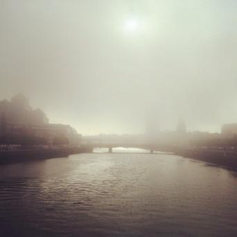 The Dublin city skyline was immersed in a dense fog. Twitter credit: @CliveWelsh