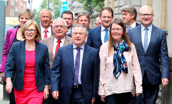 Labour Party leader Brendan Howlin with Oireachtas and former members on Kildare Street yesterday Photo: Tom Burke