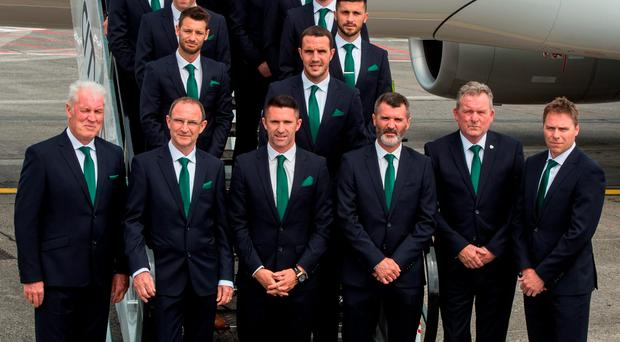 The Republic of Ireland management, front row, from left, goalkeeping coach Seamus McDonagh, manager Martin O'Neill, captain Robbie Keane, assistant manager Roy Keane, coach Steve Walford and coach Steve Guppy with the Ireland Euro 2016 squad at Dublin Airport yesterday Picture: Sportsfile