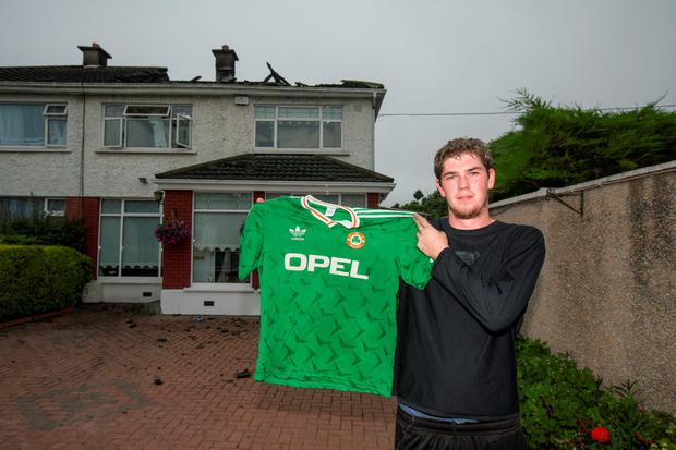 Liam Stenson with his Ireland jersey, which survived the house fire on Walnut Rise in Glasnevin Photo: Mark Condren