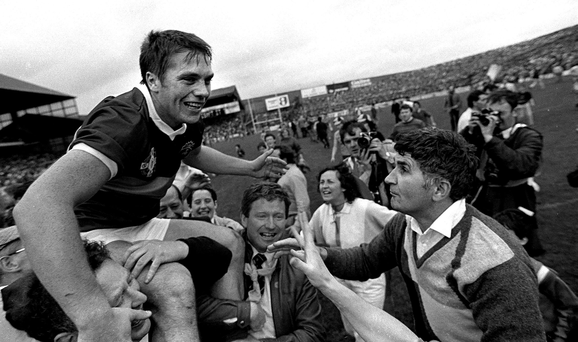 Kerry captain Páidí Ó Sé is held aloft alongside Mick O'Dwyer after victory over Dublin in the 1985 final