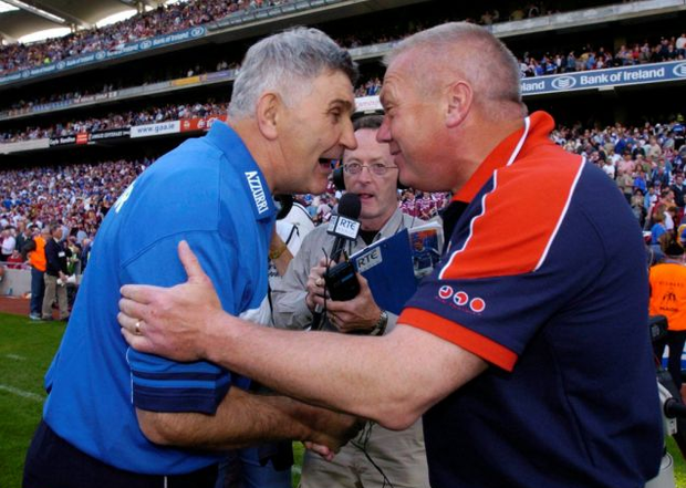 Páidí Ó Sé, then Westmeath manager shakes hands with O'Dwyer, then Laois boss