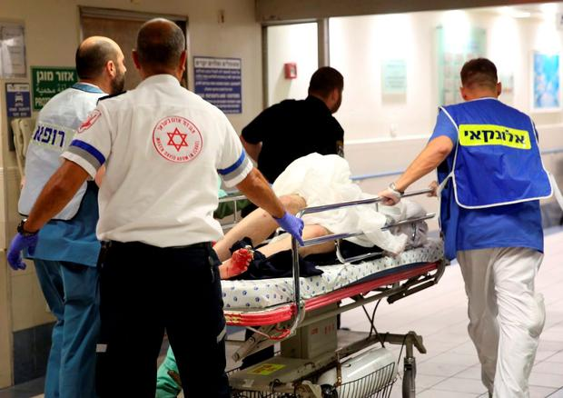 An injured person is taken into the emergency room following a shooting attack that took place in the center of Tel Aviv. Photo: Reuters